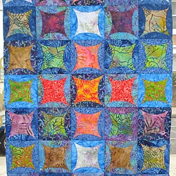 Batik Quilt with folded windows made at Tikki Patchwork in London England