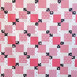 disappearing nine patch patchwork quilt in Tilda fabrics red white and black