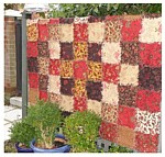Vintage Frills ragged edge quilt where the front and back is made at the same time, quilted square by square, so no need for a backing